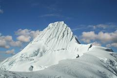 High summit alpamayo in cordilleras Stock Photos