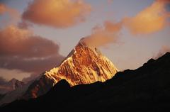 sunset in the base camp alpamayo - stock photo