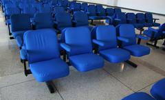 Blue arm-chair in airport Stock Photos