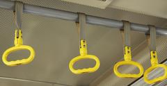 Yellow handholds in the airport bus Stock Photos