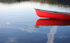 Red canoe reflection Stock Photos