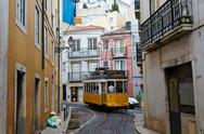 Classic yellow tram in alfama quater in lisbon, portugal Stock Photos