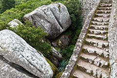 rocks and wall in moorish castle near lisbon, portugal - stock photo