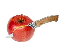 apples have been cut with a knife - stock photo