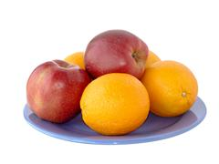 apples and oranges on a plate - stock photo