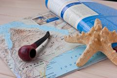 starfish and the pipe on the geographical journal - stock photo
