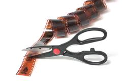 scissors cut film isolated on white background - stock photo