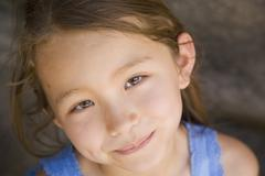 Close up of Asian girl smiling - stock photo