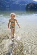 Asian girl splashing in lake Stock Photos