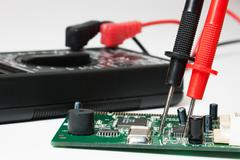 Stock Photo of digital multimeter and electronic boards