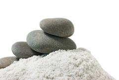 Pile of pebbles in a handful of sea salt Stock Photos