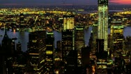 Stock Video Footage of Aerial view of Manhattan illuminated at night, New York, USA