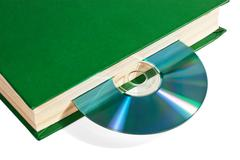 cd in the book - stock photo
