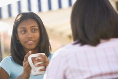 African teenaged girl talking to friend Stock Photos