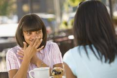 African teenaged girl talking to friend - stock photo