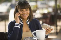 African teenaged girl talking on cell phone Stock Photos