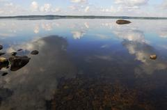 The sky is reflected in shallow backwater Stock Photos