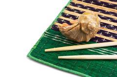 Stock Photo of chopsticks and shells