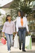 African teenaged girls carrying shopping bags Stock Photos