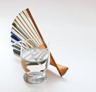 glass of clean water and   fan - stock photo