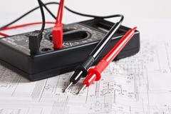 digital multimeter and an electronic circuit - stock photo