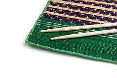 chopsticks and bamboo plate - stock photo