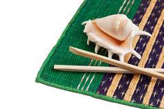 chopsticks and shells - stock photo