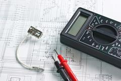digital multimeter and  lamp - stock photo