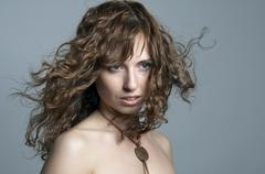 pretty young woman looking with passion - stock photo