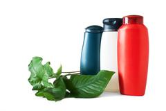 Bottle of shampooand green leaves Stock Photos