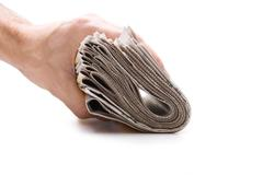 Hand holds a bundle of newspapers Stock Photos