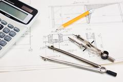 technical drawings and  calculator - stock photo