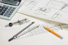 Stock Photo of technical drawings and  calculator