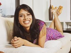 Stock Photo of Indian woman laying on sofa