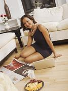 Hispanic woman with cheese plate on floor Stock Photos
