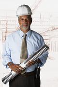 African businessman wearing hard hat Stock Photos