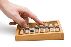 calculation on wooden accounts - stock photo