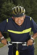 Stock Photo of Hispanic man riding bicycle