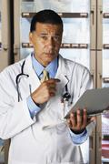 African male doctor holding chart Stock Photos