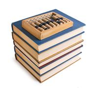 wooden abacus on a pile of books - stock photo