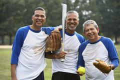 Multi-ethnic men with baseball gear Stock Photos