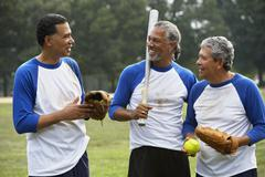 Stock Photo of Multi-ethnic men with baseball gear