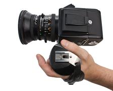 hand holds the handle of the camera - stock photo