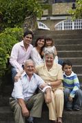 Multi-generational Hispanic family sitting on steps Stock Photos
