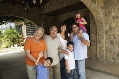 Multi-generational Hispanic family under overpass - stock photo