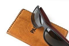 passport and sunglasses - stock photo