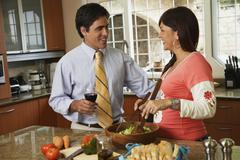 Hispanic couple smiling at each other Stock Photos