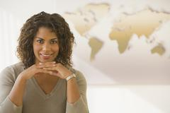 African businesswoman in front of world map Stock Photos