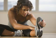 African woman stretching - stock photo
