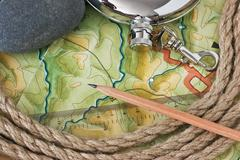 topographic maps and flask - stock photo